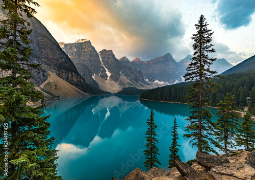 Foto op Canvas Groen blauw Sunrise with turquoise waters of the Moraine lake with sin lit rocky mountains in Banff National Park of Canada in Valley of the ten peaks.
