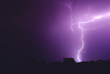 Flash Of Lightning In The Night Sky Color It In An Incredibly Beautiful Violet Color Illuminating The Trees