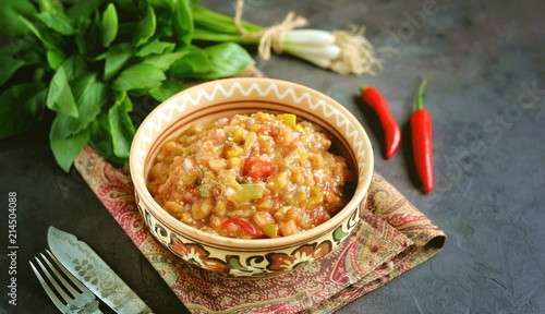 Middle Eastern cuisine - babaganush (eggplant caviar) from baked eggplant and pepper, with tomatoes, chili pepper, onion with olive oil and sea salt.