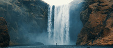 Woman Overlooking Waterfall At...