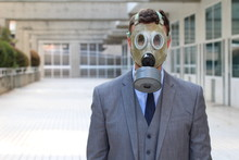 Businessman Wearing Gas Mask In Office Space