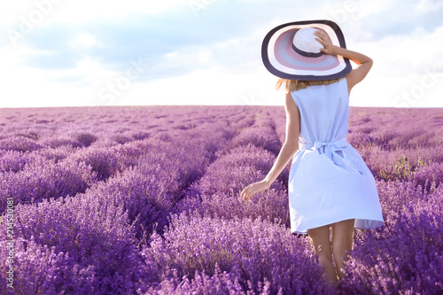 Young woman in lavender field on summer day