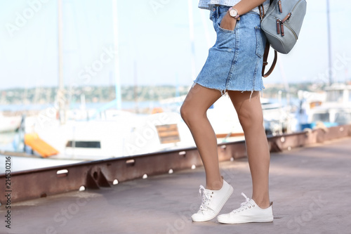 Canvastavla Young hipster woman in jean skirt on pier