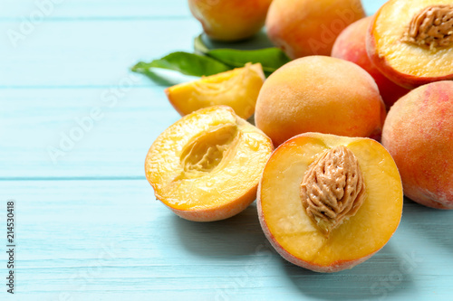 Fresh sweet peaches on wooden table, closeup