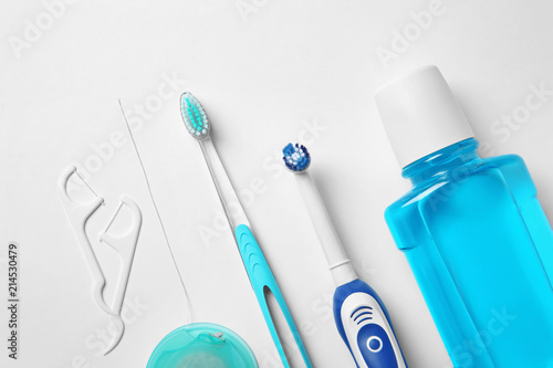Cuadros en Lienzo Flat lay composition with toothbrushes and oral hygiene products on white backgr