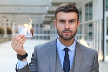 Man Burning Dollar Bill In Office Space