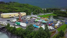 Active Carnival Event With Amusement Rides Along The Shore Waterfront, (Valdez, Alaska) (Drone Shot)