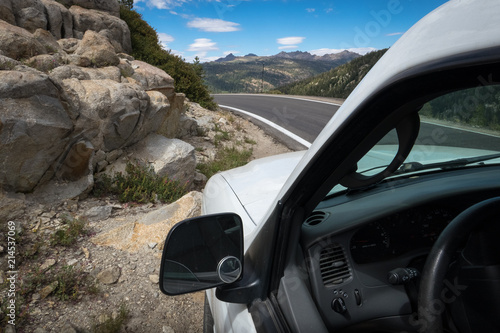 Keuken foto achterwand Verenigde Staten View of White Car Interior and Exterior, Stopped on Rocky Mountain Road