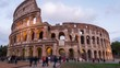 Roman Colosseum and tourists as night falls in Rome, Italy, timelapse (people blurred for commercial use)