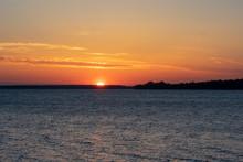 Sunrise/Sunset Over Lake Champ...