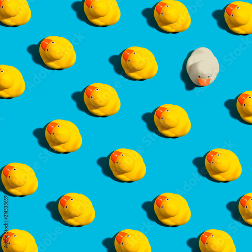 One out unique rubber duck concept on a blue background Fototapeta