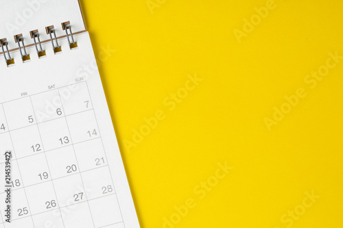 Fotomural White clean calendar on solid yellow background with copy space, business, trave