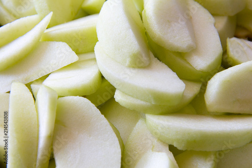 Fototapeta Sliced apple wedges for a healthy snacks or to make an apple pie