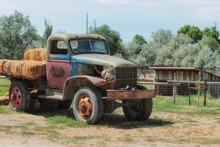 Rusted And Old Farm Vehicle Carrying Hay Bales