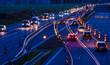 canvas print picture - eine Autobahnbaustelle bei Nacht mit starkem Fahrzeugverkehr