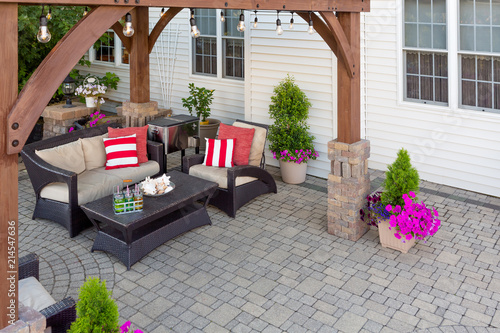 Obraz Comfortable chairs on an outdoor brick patio - fototapety do salonu