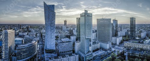 Fotografiet Warsaw city with modern skyscraper at sunset-Panorama