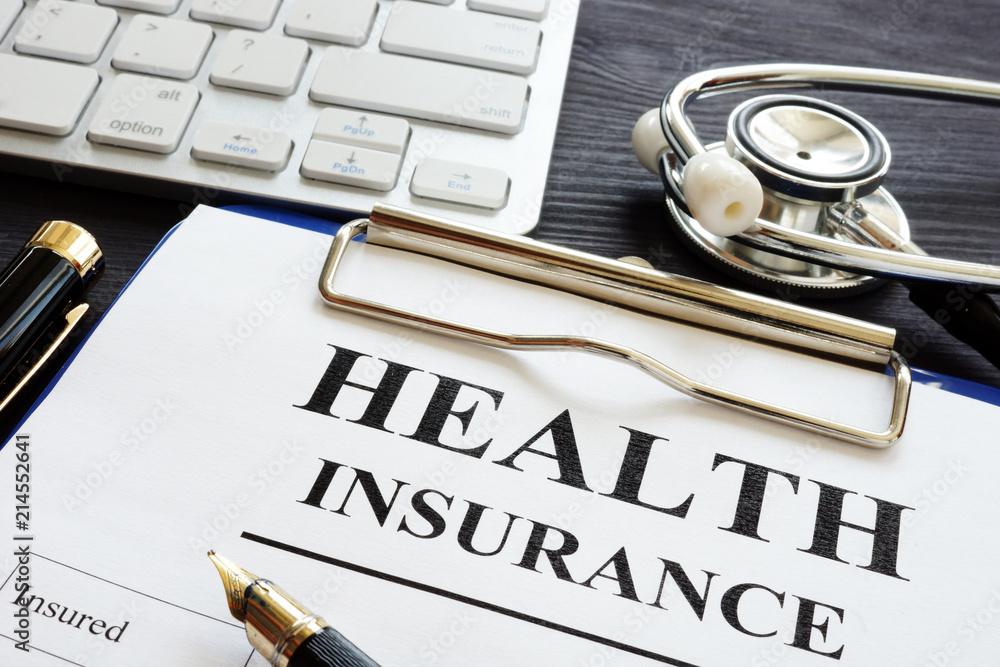 Fototapeta Individual health insurance policy and stethoscope.