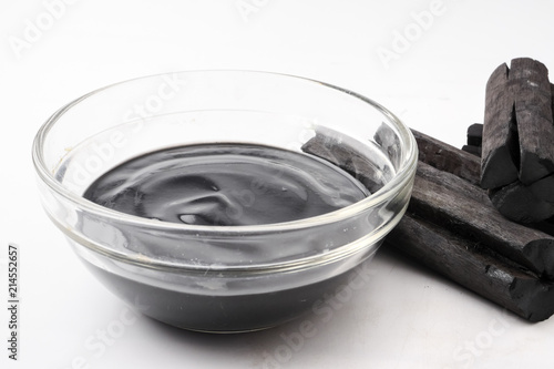 Facial mask and scrub by activated charcoal  on white background Canvas Print