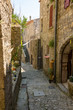 View into a small narrow cobblestone alley in the medieval village Labeaume an der Ardeche in France