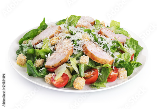 Fotografia Caesar salad with chicken fillet and parmesan cheese isolated on white background