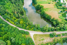 Aerial View Of Countryside And Lake. Forest Along Water