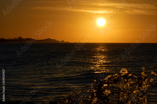 Tuinposter Chocoladebruin Seascape during sunset, dark water with golden sun path and even