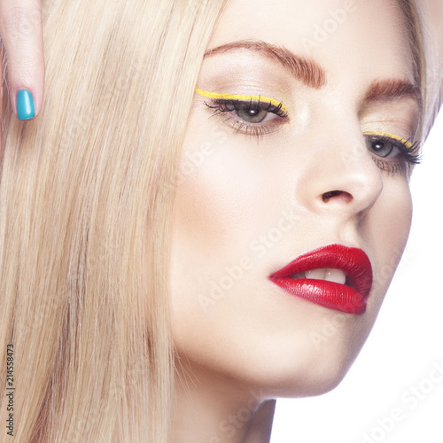 Foto op Aluminium Kapsalon Close-up beauty face of model girl with yellow eyeliner on eyes, bright red lips make-up and clean skin