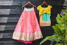 Indian Saree (sari) Wedding Dress And Blouse Hanging On The Wooden Wall