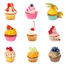 Set Of Different Cupcakes Isolated On White Background.