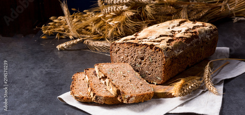 Leinwand Poster delicious and healthy home-made wholegrain bread with honey