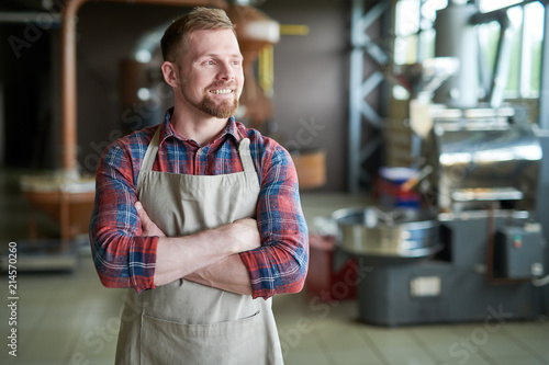 Waist up portrait of cheerful bearded man wearing apron posing standing confiden Canvas Print