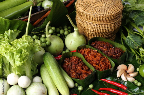 Fototapeta Famous Thai Food Hot and Spicy sauce with local ingredient fresh herb, paste sauce and vegetable arrange set , South East Asia style healthy food low price Top view on banana leaf obraz na płótnie