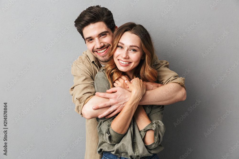 Fototapeta Lovely young couple hugging