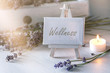 canvas print picture - Spa or wellness still life: little image with lot of lavender in front of vintage wooden furniture and candlelight
