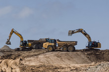 CONSTRUCTION MACHINERY - Tipper Trucks And Excavators On Construction Side
