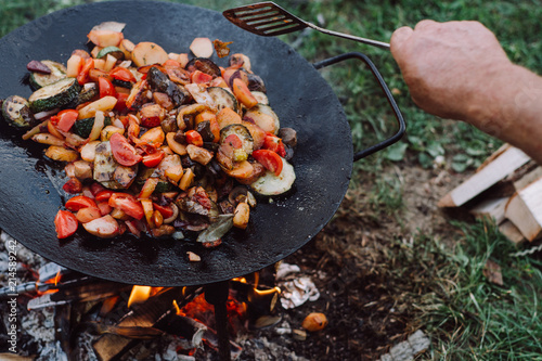 Spoed Foto op Canvas Grill / Barbecue Cooking vegetables and food over an open fire on outdoor.