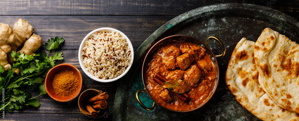 Fototapety, obrazy: Chicken tikka masala spicy curry meat food with rice and naan bread on dark background