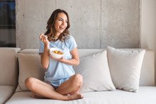 Happy Young Woman Eating Healt...