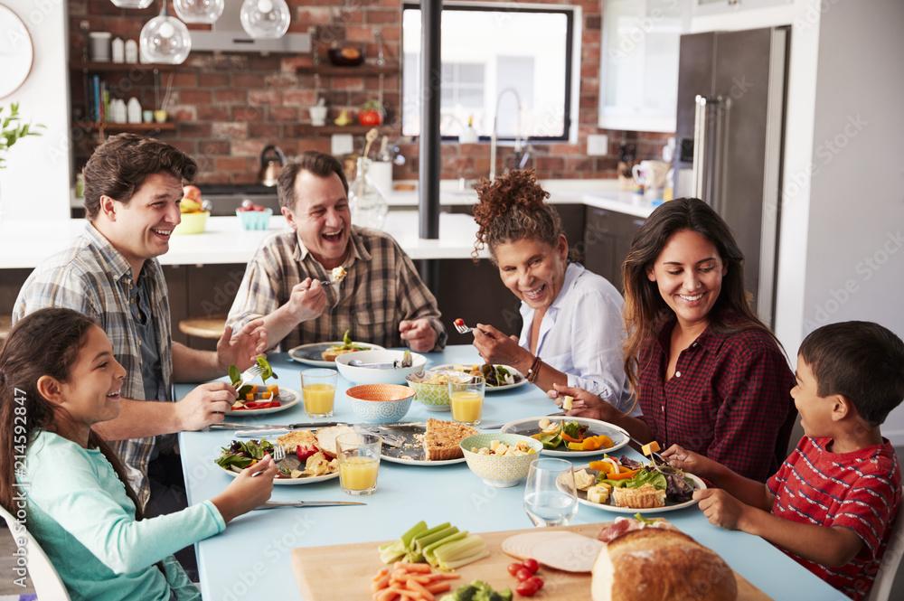 Obraz Multi Generation Family Enjoying Meal Around Table At Home Together fototapeta, plakat