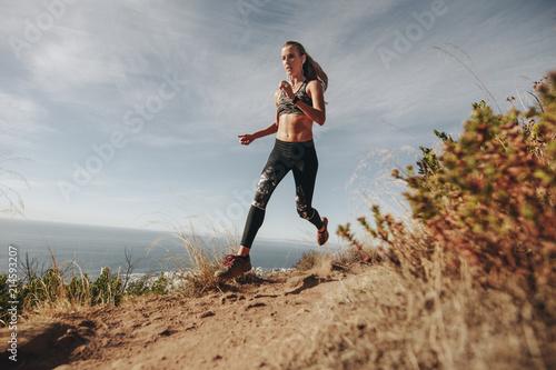 Trail runner running down hill