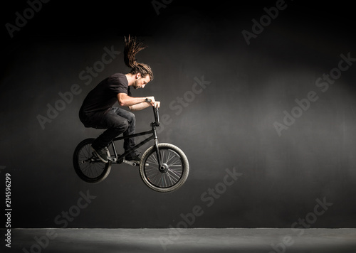 Young man doing a stunt on his BMX bicycle.