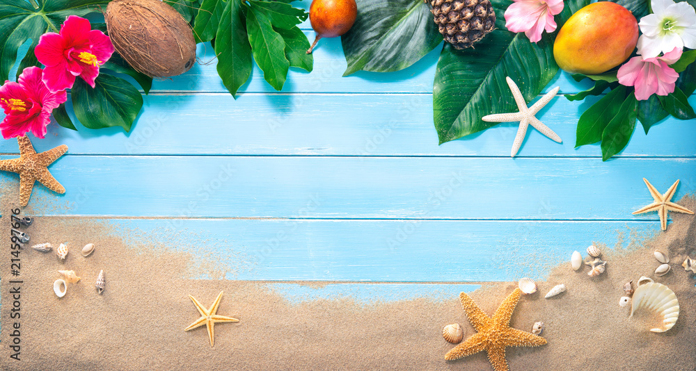 Fototapeta Holidays background with tropical flowers, leaves, exotic fruits and seashells on sand beach