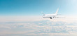 Passenger aircraft cloudscape with white airplane is flying in the evening sky overcast, panorama view.