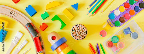 Day care concept - art supplies and toys on bright background