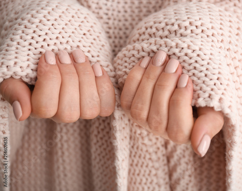 Young woman with beautiful manicure, closeup
