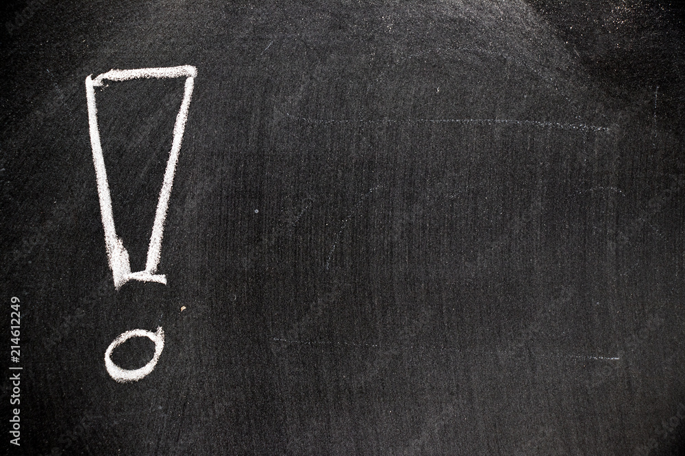 Fototapety, obrazy: White color chalk hand drawing in exclamation mark with blank space shape on blackboard background