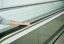 Woman Holding On Handrail When...