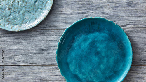 Cuadros en Lienzo Two porcelain blue bowls on a gray wooden table