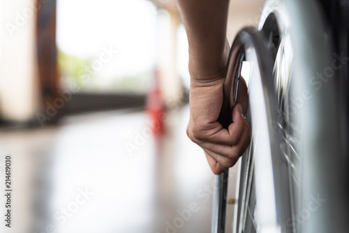 closeup disabled man hand on wheel of wheelchair Canvas Print